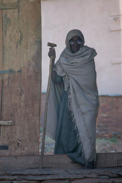 Picture of Abreha wa Atsbeha church (Ethiopia): Old woman leaving Abreha and Atsbeha church