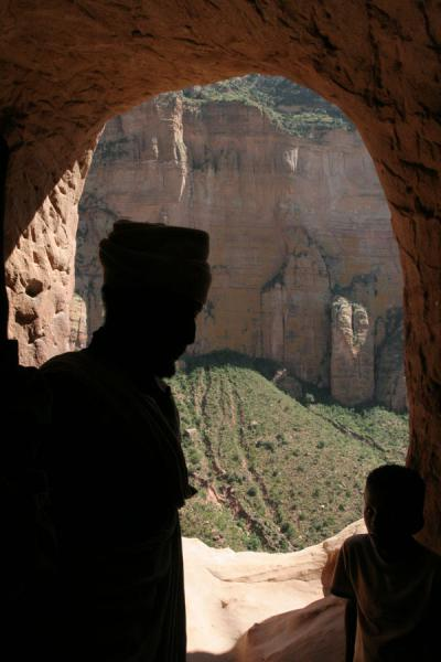Picture of Abuna Yemata Guh church (Ethiopia): Silhouette of priest stepping out of Abuna Yemata Guh: stunning views