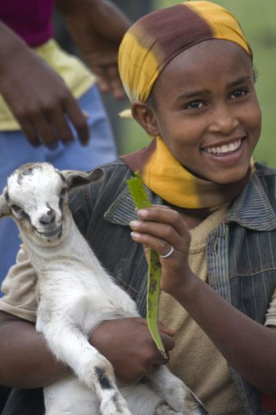 Foto di Ethiopian girl with smile and her small goatAwassa - Etiopia