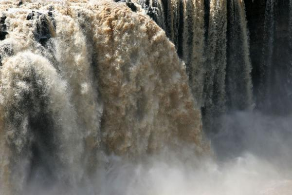 Water falling and being thrown up in the air at the main waterfall of Blue Nile falls | Blue Nile Falls | Ethiopia