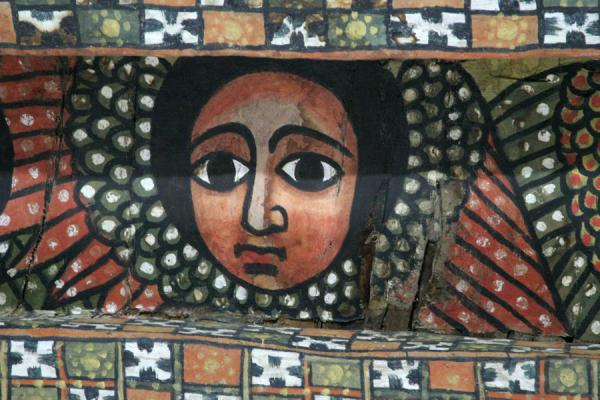 Close-up of one of the angels in the ceiling of Debre Birhan Selassie | Debre Birhan Selassie Church | Ethiopia