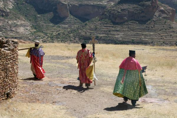 Picture of Debre Damo Monastery (Ethiopia): Debre Damo monastery: priests walking on the flat-topped hill