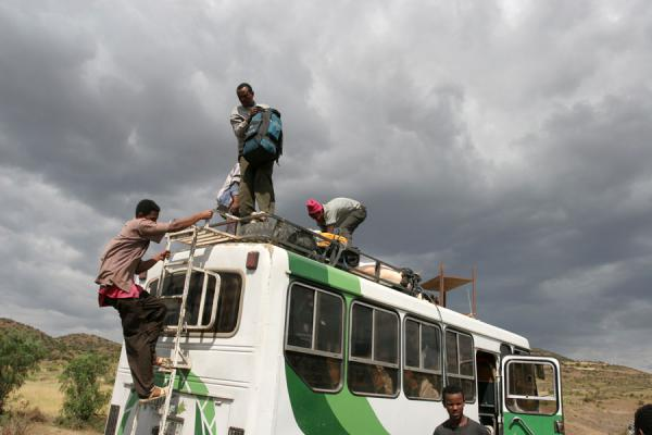 Picture of Ethiopian buses (Ethiopia): Luggage being offloaded from a bus in the middle of nowhere