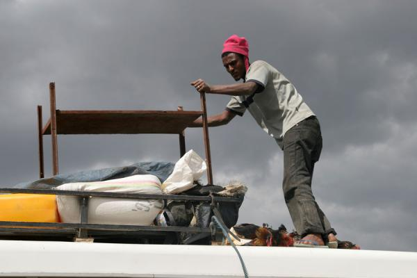 Taking care of luggage on the roof of the bus | Ethiopian buses | Ethiopia