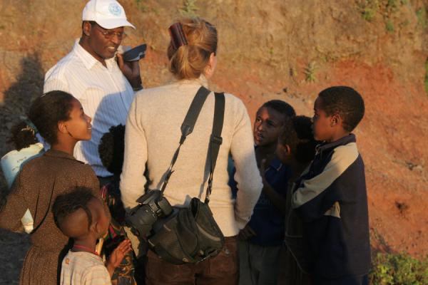 Picture of Ethiopian kids crowding around a European visitor - Ethiopia - Africa
