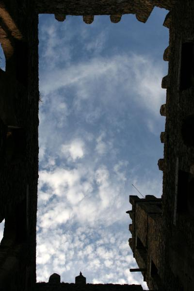 Sky through the roof: looking up inside one of the castles of Gonder | Fasil Ghebbi | Ethiopia