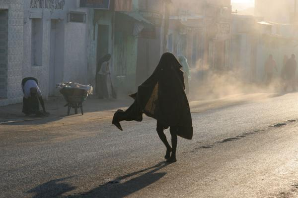 Man walking the streets of Harar in the early morning | Harar Street Scenes | Ethiopia