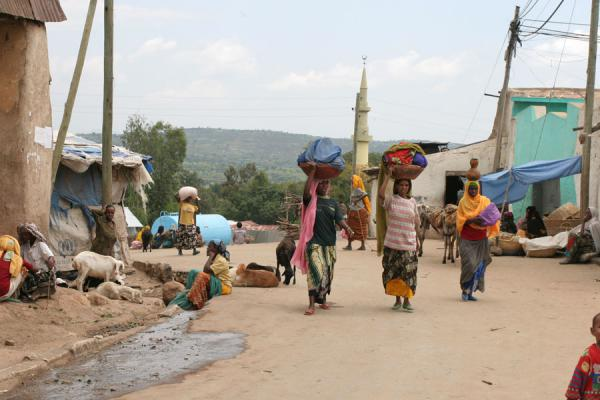Picture of Harar Street Scenes (Ethiopia): Close to Oromo market in Harar: women walking with wares