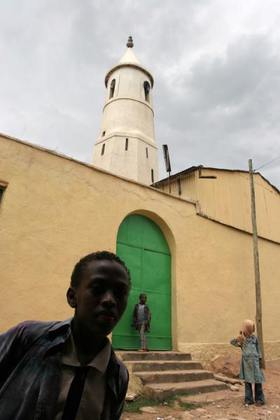 Picture of Harar Street Scenes (Ethiopia): Local boy and one of the many mosques in Harar