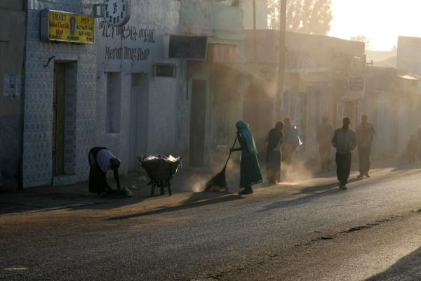 People in the dusty streets of Harar in the early morning | Harar Street Scenes | Ethiopia