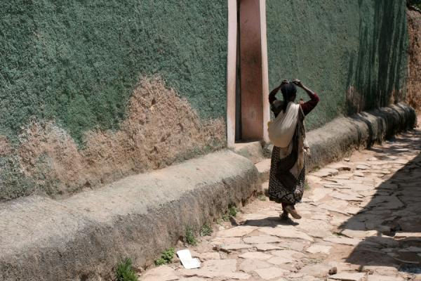 Picture of Harar Street Scenes (Ethiopia): Woman walking past a typical house in Harar