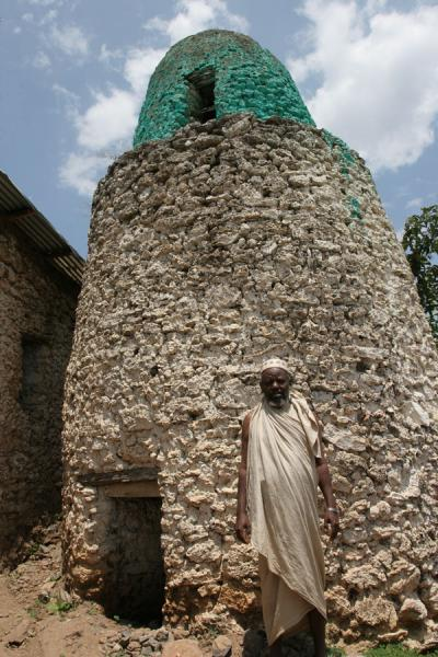 Koremi man posing in front of the minaret | Koremi | Ethiopia