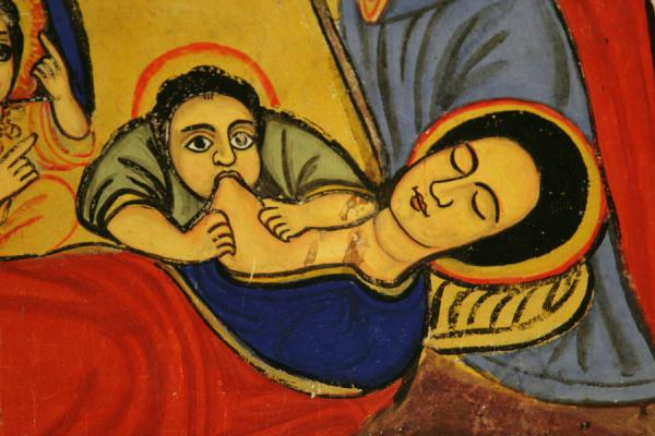 Thirsty holy figure eagerly breastfeeding: mural in Ura Kidane Mihret church | Lake Tana monasteries | Ethiopia