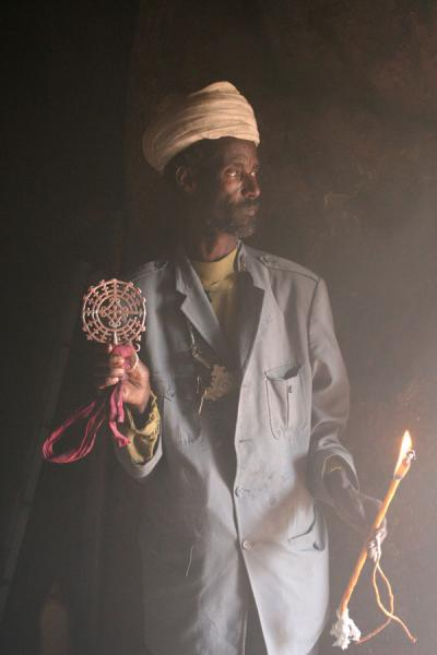 Priest with cross in Bilbilla Giyorgis | Lalibela priests | Ethiopia