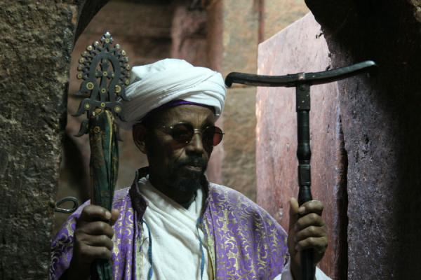 Priest showing treasures of Bet Golgotha church | Lalibela priests | Ethiopia