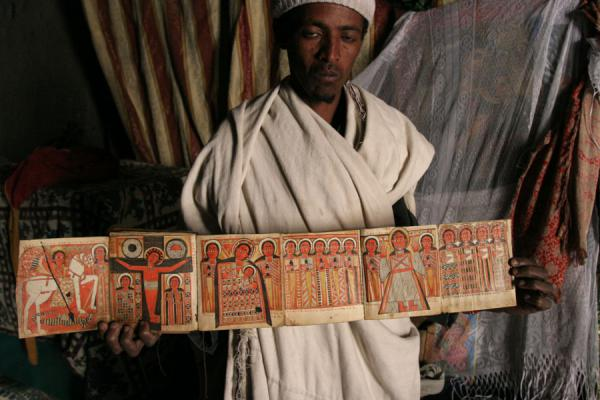 Priest showing cartoon-like goat skin book in Asheton Maryam | Lalibela priests | Ethiopia