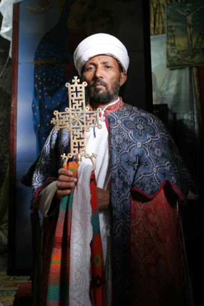 Priest of Bet Maryam showing the cross of the church | Lalibela priests | Ethiopia