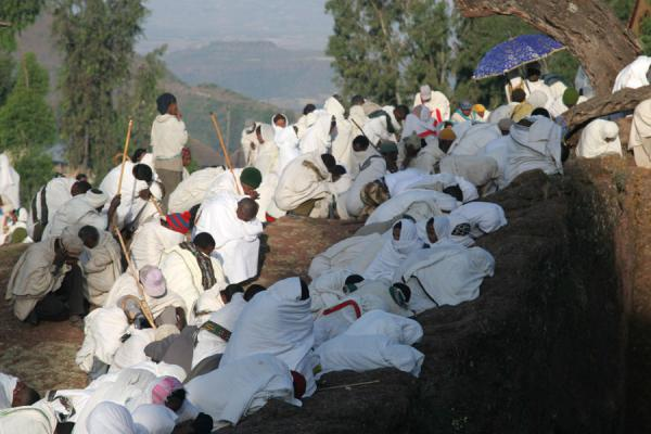 Sunlight reaches the worshippers as they lie on the floor in prayer | Lalibela Sunday Mass | Ethiopia