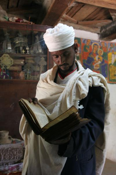 Picture of Yeha (Ethiopia): Priest of the church of Yeha reading one of the ancient goat skin books