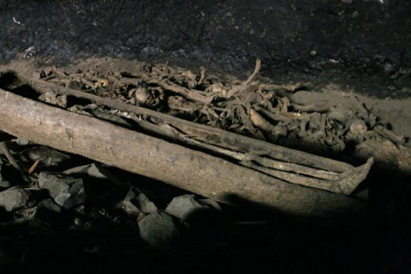 Picture of Yemrehanna Kristos church (Ethiopia): Skeleton in coffin in cavern behind Yemrehanna Kristos church