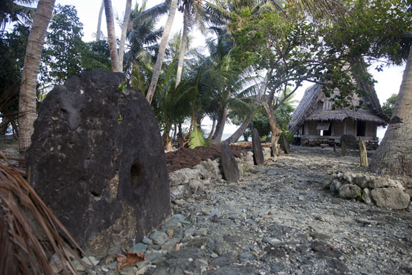 Picture of Balabat Stone Money Bank (Federated States of Micronesia): Stone money bank of Balabat with platform and men's house
