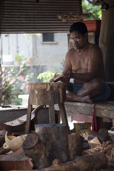 Picture of Artist working to create a wooden sculpture in Porakiet - Federated States of Micronesia - Oceania