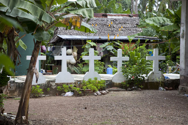 Picture of Backyard with row of tombs in Porakiet, the Polynesian part of Kolonia - Federated States of Micronesia - Oceania