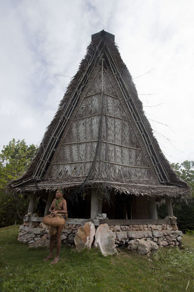 Chief in front of the men's house of Tamil | Tamil village | Federated States of Micronesia