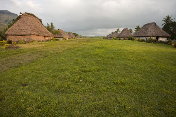 The main avenue of Navala with traditional thatched roof bure on both sides | Navala | Figi