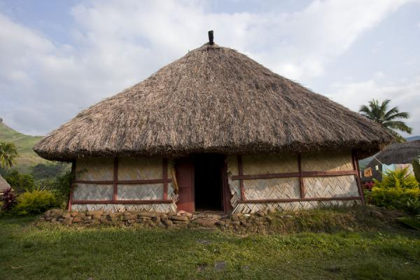 Frontal view of a thatched roof bure in Navala | Navala | Fidji