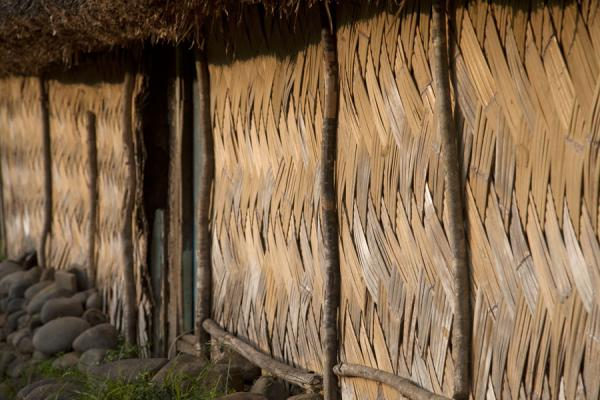 Foto van Side view of the bamboo wall of a traditional bure in NavalaNavala - Fiji