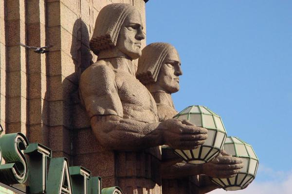 Picture of Strong men sculpted at the main entrance of the central station - Finland - Europe