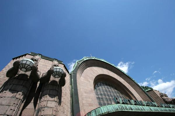 Picture of Entrance of Helsinki railway station: statues, lanterns and facade
