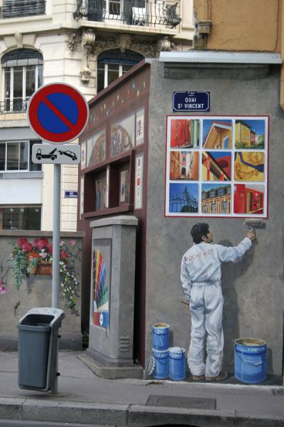 Painter painting a wall as a trompe l'oeil | Lyon street art | France