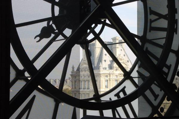 Picture of Louvre seen through the clock in Musée d'Orsay