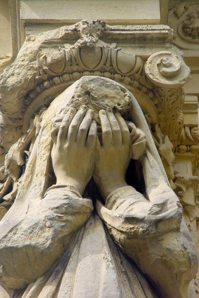 Picture of Père Lachaise Cemetery (France): Weeping statue at Pere Lachaise, Paris
