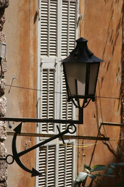 Lantern and window shades in a backstreet of Villefranche sur Mer | Villefranche sur Mer | France