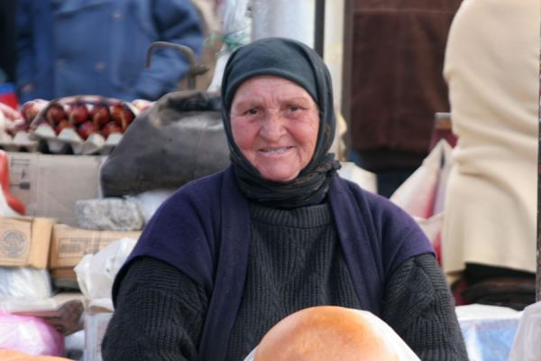 Old Georgian woman selling bread at a street market | Georgian People | Georgia
