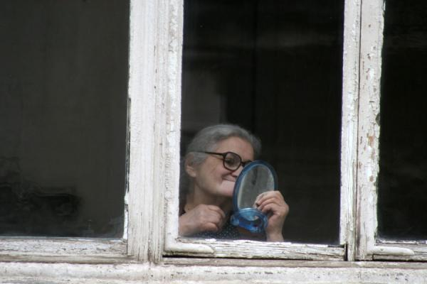 Picture of Georgian People (Georgia): Georgian woman looking into the mirror in Tbilisi