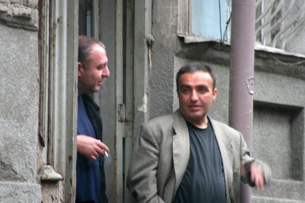 Picture of Georgian People (Georgia): Georgian men chatting outside a house in Tbilisi