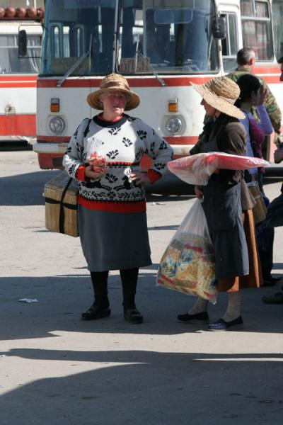 Picture of Georgian women trying to sell snacks at busstation