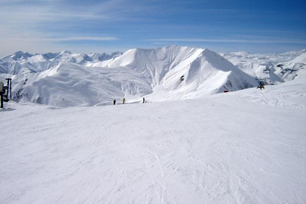 Picture of Gudauri Skiing (Georgia): Ski-slope of Gudauri area with snowy Kaukasus mountains
