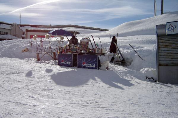 Stall with food and drinks, and typical Georgian snow hats | Gudauri Skiing | Georgia