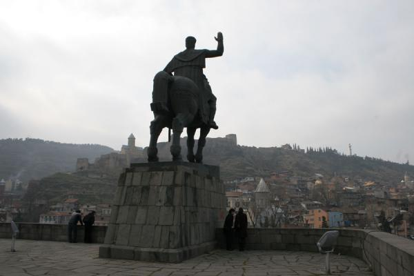 Picture of King Vakhtang Gorgasal statue with Narikala Fortress in a distanceTbilisi - Georgia