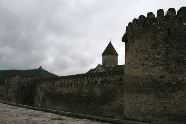 Picture of Sveti-Tshkoveli cathedral, walls, and Jvari church in the backgroundMtskheta - Georgia