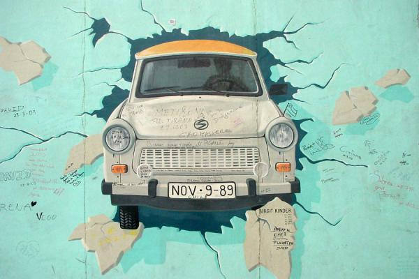 Picture of Trabant coming out of Berlin Wall, East Side Galley