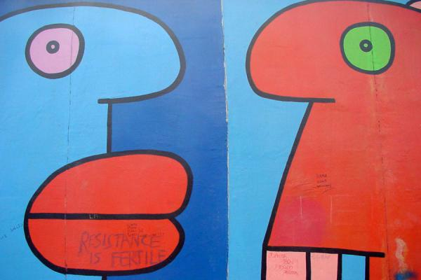 Detail of a colourful piece of art (Thierry Noir, France) | East Side Gallery | Germany