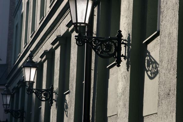 Lanterns against a wall in the city centre | Munich architecture | Germany