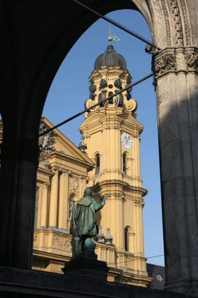 Belltower of Theatinerkirche seen from behind Preysing palace | Munich churches | Germany