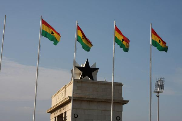 Picture of Independence Square (Ghana): The Black Star on top of the Independence Arch with Ghanaian flags in the foreground